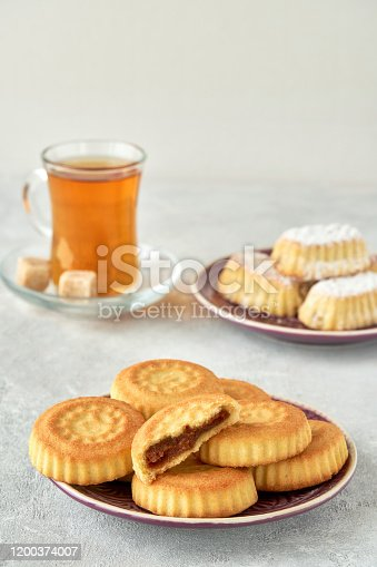 963384046 istock photo Traditional arabic sweets with dates and walnut. Maaamoul cookies 1200374007