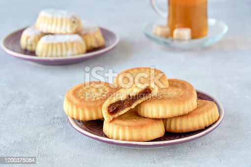 1152965481 istock photo Traditional arabic sweets with dates and walnut. Maaamoul cookies 1200375084