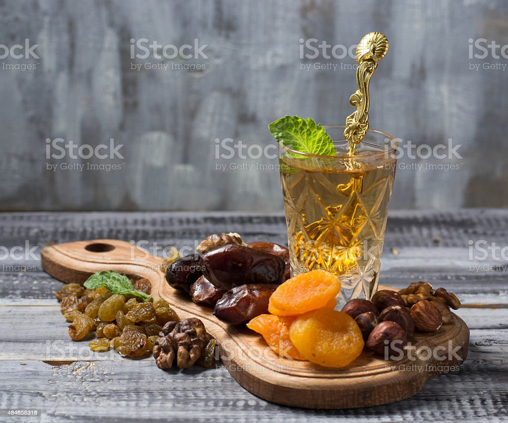 Traditional arabic tea and dry fruits stock photo