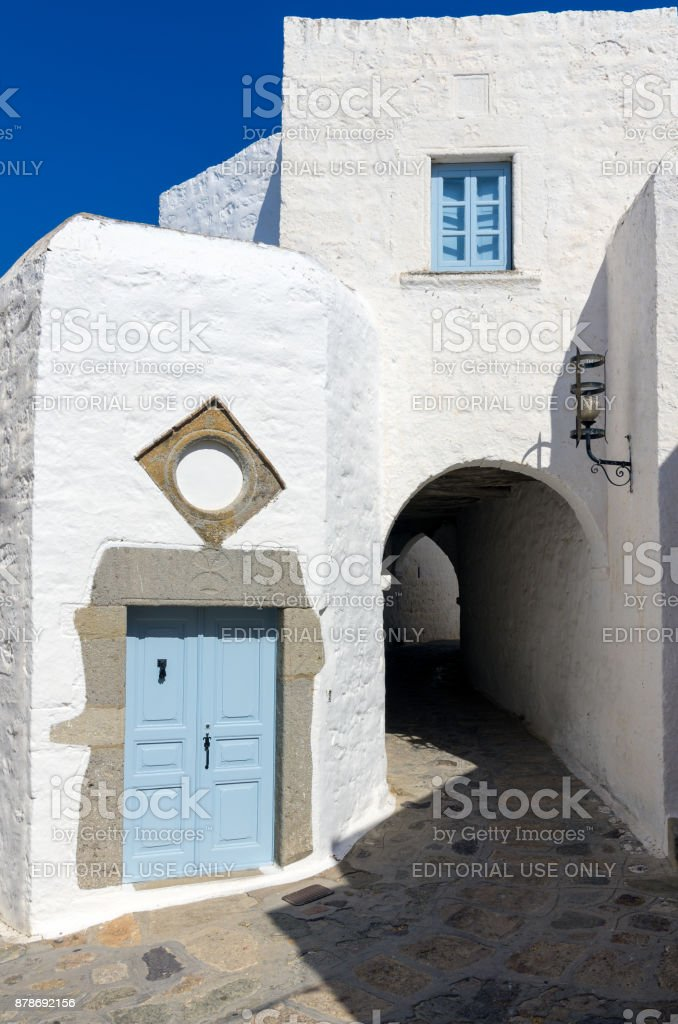 Traditional  architecture in the chora of Patmos island, Dodecanese, Greece Patmos island, Greece - August 21st 2017 - Traditional  architecture in the chora of Patmos island, Dodecanese, Greece Alley Stock Photo