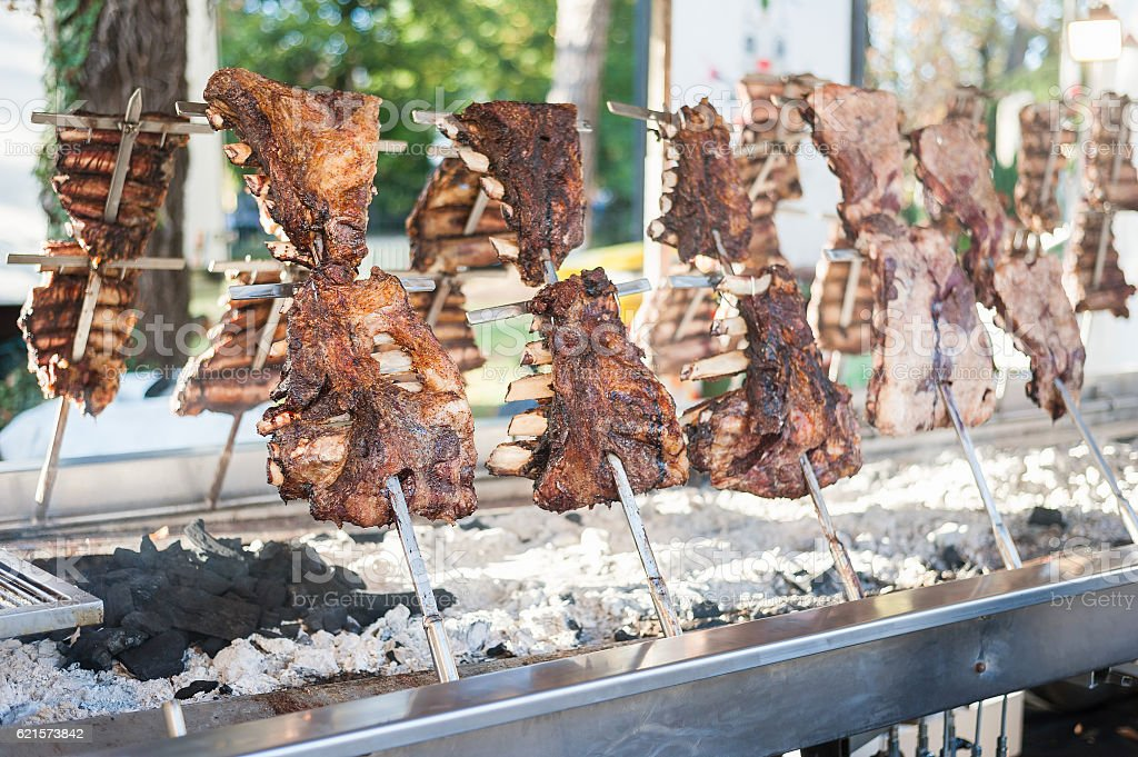 Traditional Argentinian asado roasted lamb grilled meat. - foto de stock