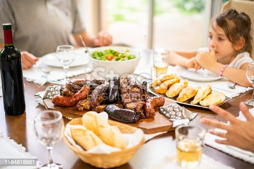 Traditional Argentinian meal with barbecue grill and empanadas.