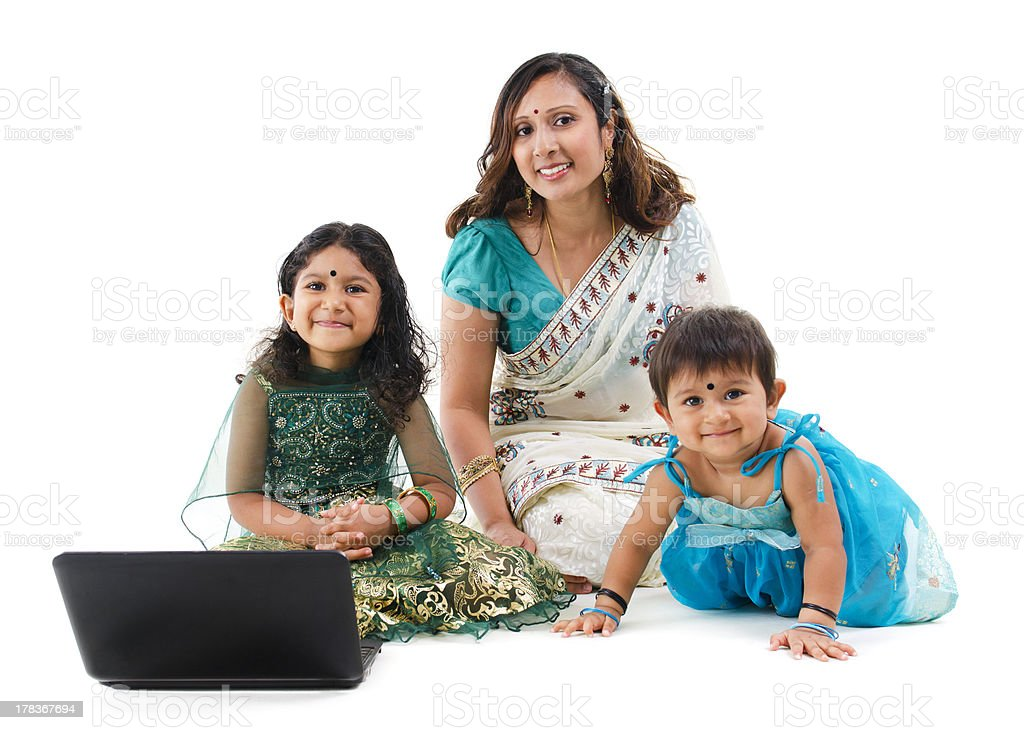 Traditional Asian Indian family using laptop computer over white background royalty-free stock photo