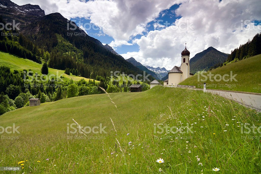 traditional austrian church with mountains in background stock photo