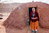 Traditional Authentic Navajo Elderly Woman Posing in Traditional Clothing near a Hogan in Monument Valley Arizona
