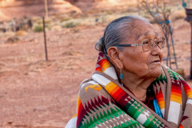 Traditional Authentic Navajo Elderly Woman Posing in Traditional Clothing in a Hogan in Monument Valley Arizona stock photo