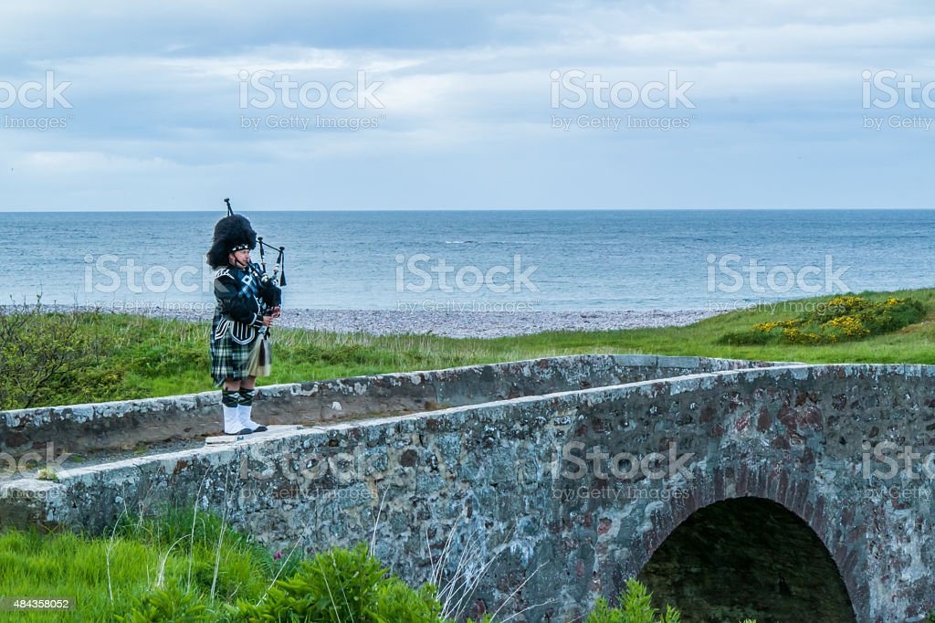Traditional bagpiper in the scottish highlands near Pennan stock photo