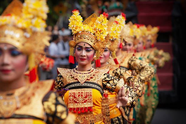 Traditional Balinese dance Legong DENPASAR, BALI ISLAND, INDONESIA - JUNE 23, 2018: Face portrait of beautiful young Balinese women in ethnic dancer costume, dancing traditional temple dance Legong at art and culture festival parade. indonesia stock pictures, royalty-free photos & images