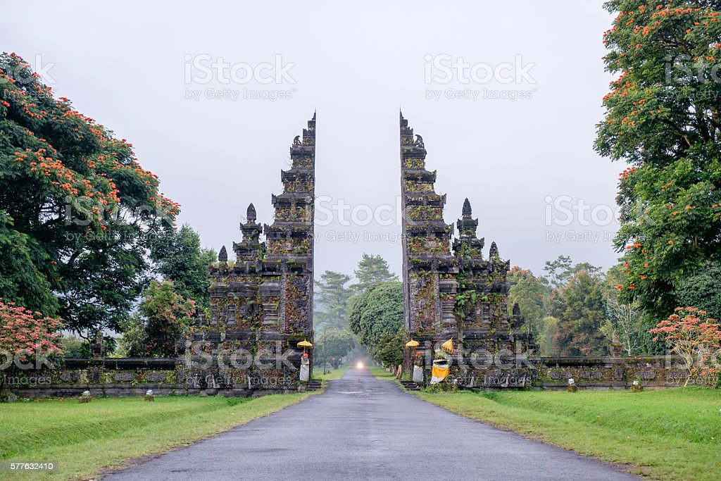 Traditional Balinese Hindu gate at rainy summer day with clouds stock photo