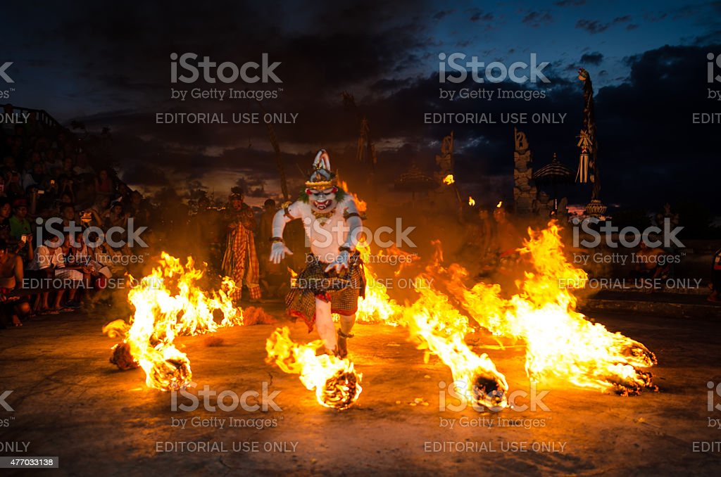 Traditional Balinese Kecak Dance at Uluwatu Temple, Bali, Indonesia Bali, Indonesia - March 15, 2015: Traditional Balinese Kecak Dance at Uluwatu Temple in Bali, Indonesia. Kecak also known as Ramayana Monkey Chant, is very popular cultural show on Bali. 2015 Stock Photo