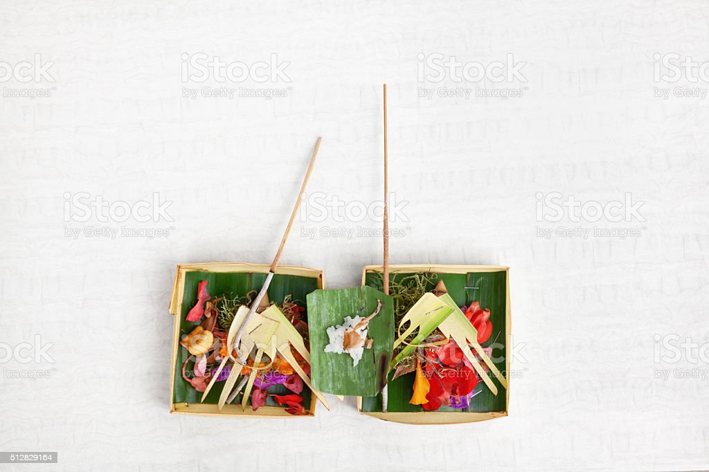 Traditional balinese offering on light background stock photo