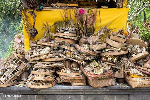 Traditional balinese offerings to Gods burned Indonesia Bali temple in Ubud