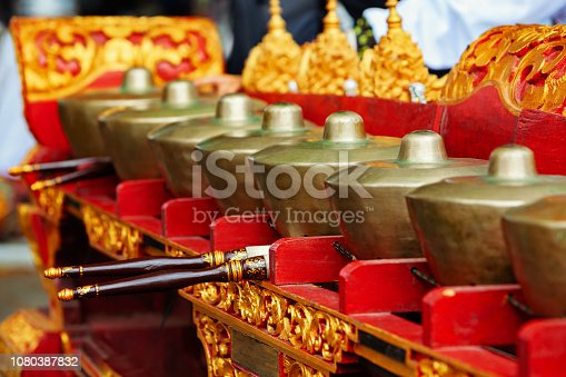 Musical instrument Reyong ( Reong) - brass gongs with mallets, part of Traditional Balinese orchestra Gamelan Kebyar. Arts, music, culture of Bali and Indonesian people. Asian travel background.