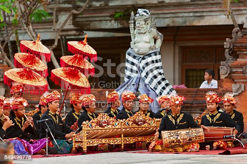 Bali: Musicians of Gamelan orchestra in Balinese people costume playing ethnic ritual music on traditional Indonesian instruments.