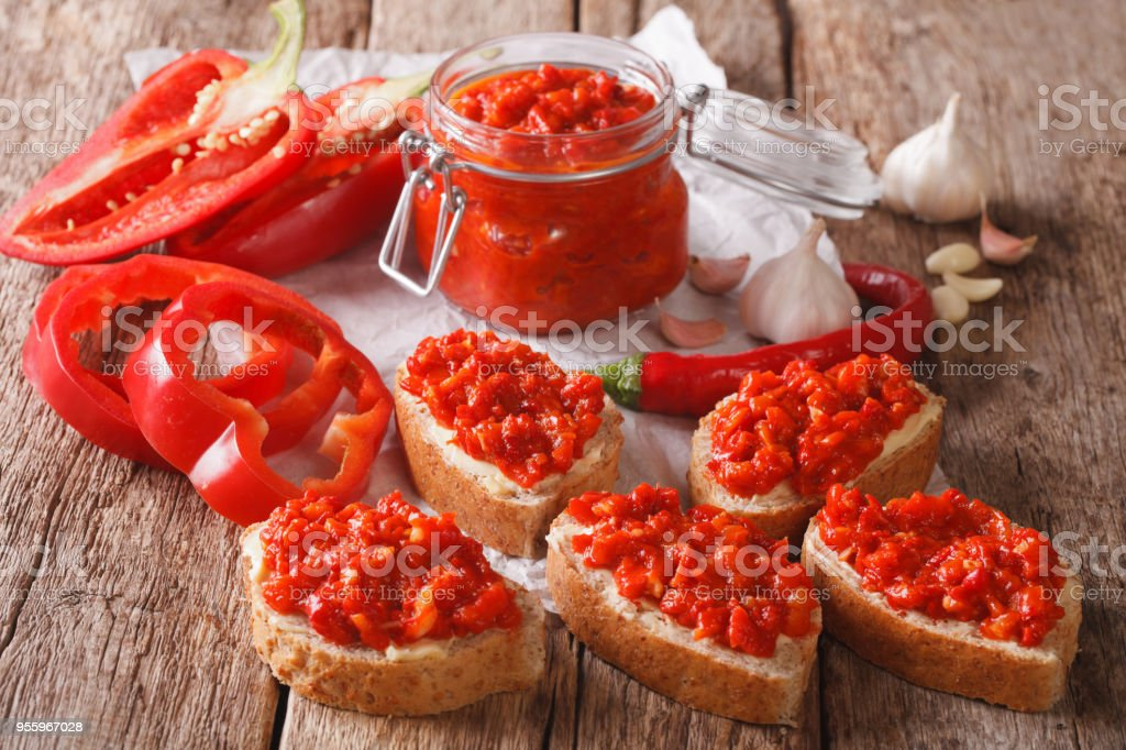 traditional Balkan ajvar from peppers with garlic close-up. horizontal stock photo