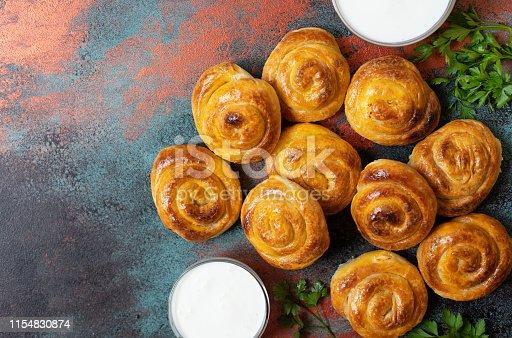 Traditional Balkan Cheese Pie spiral phyllo pastry served with yogurt. Serbian and Bosnian burek. Bulgarian banitsa. Turkish borek. Greek tiropita. Balkan cuisine. Top view. Copy space