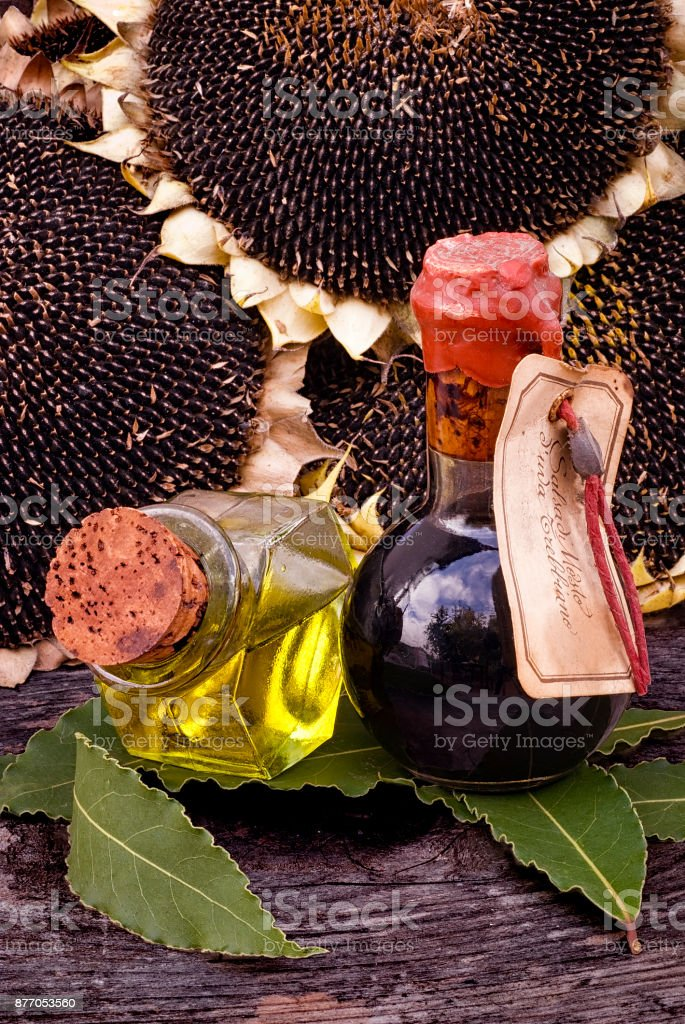 Traditional Balsamic Vinegar and pouring virgin olive oil with bay leaves stock photo