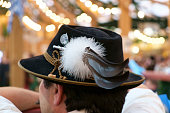 Munich, Germany - September 24, 2014: A man wearing a typical traditional hat in a tent on the Octoberfest in Munich, Germany.