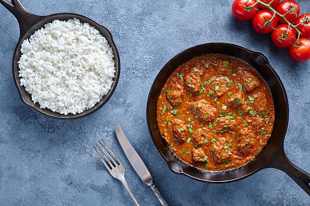 Traditional Beef Madras Indian spicy lamb food with rice and stock photo