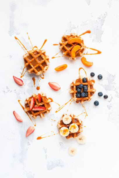 Traditional belgian waffles with fresh fruit and caramel stock photo