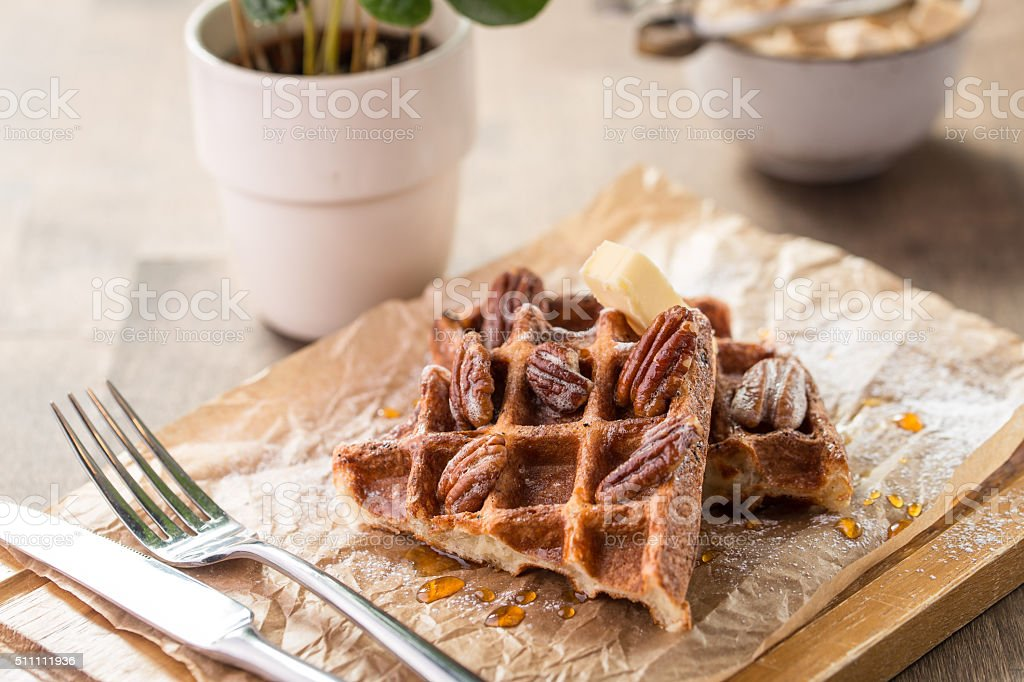 Traditional Belgian waffles with syrup and butter stock photo