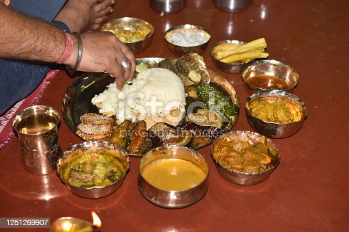 Traditional bengali food and cuisine dish, a person is eating  for birthday or (Aiburobhat) lunch the day before the wedding refers to bengali wedding with Hindu rites and rituals
