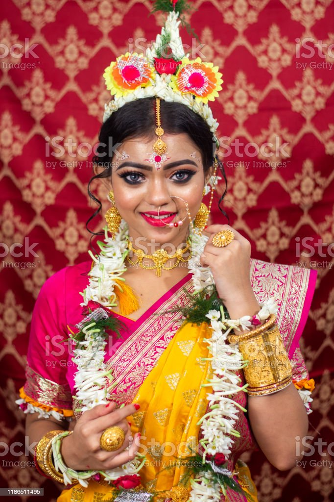 Traditional Bengali Woman In Wedding Sari And Makeup With Flowers And Garland Stock Photo Download Image Now Istock