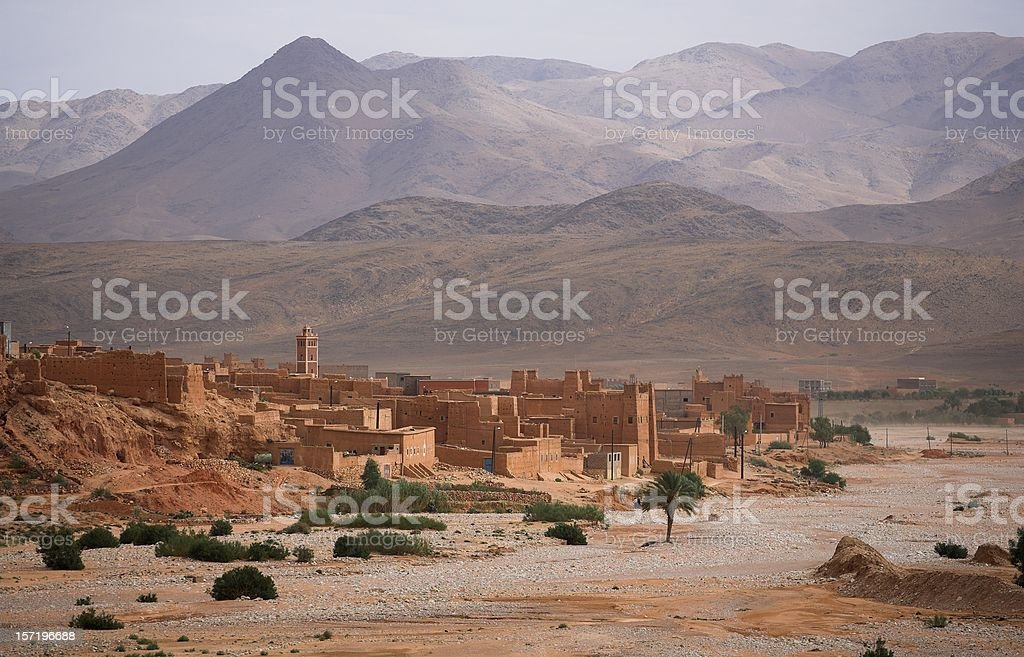 Traditional Berber town in Morocco and Atlas mountains stock photo