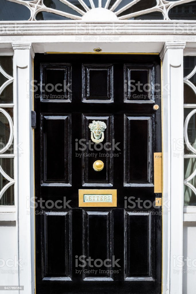 Traditional black entrance door with decorative letterbox in Dublin Ireland. royalty-free stock photo