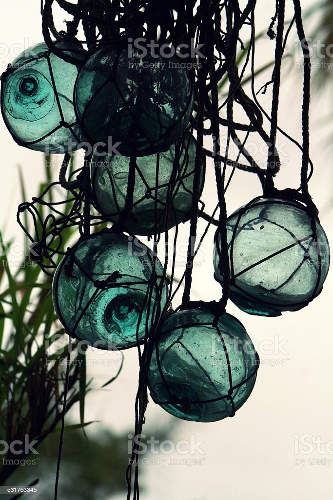 Traditional Blue Glass Fishing Floats Sway in the Breeze stock photo