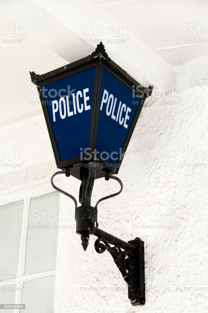 Traditional blue police lamp outside police station royalty-free stock photo