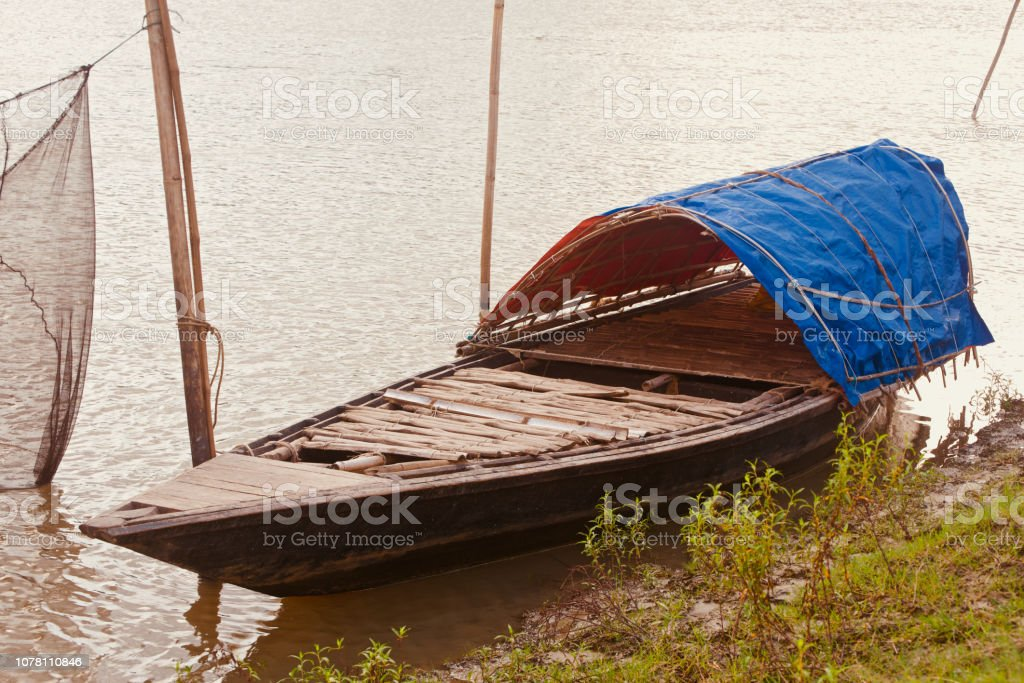 A traditional boat around the river bank area stock photo