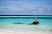 Traditional boat floating in lagoon in the Maldives