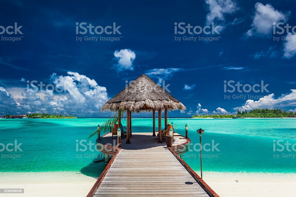 Traditional boat jetty in luxury resort of Maldives, Indian Ocea stock photo