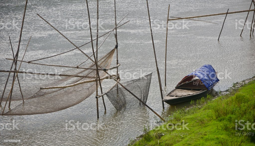 Traditional boat parked around a river bank stock photo