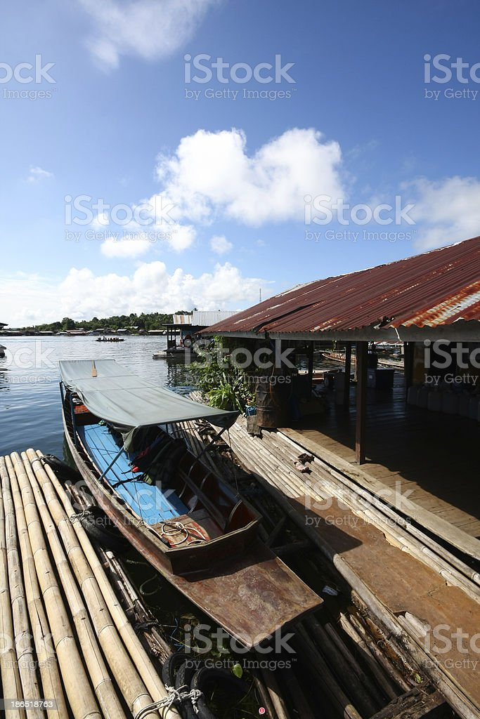 Traditional boat parked at a floating raft house royalty-free stock photo