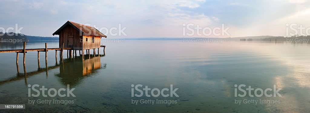 Traditional Boathouse on Lake Dock at Sunset, Ammersee, Bavaria, Germany stock photo