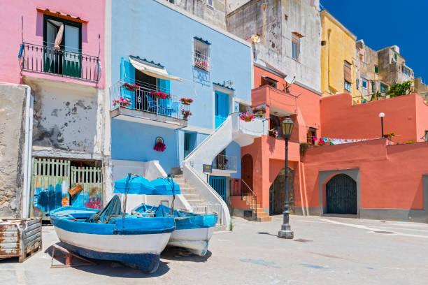 traditional boats and specific architecture near marina corricella on the island of procida, bay of naples, italy. - procida foto e immagini stock