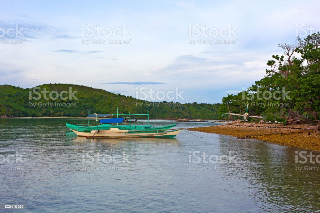 Traditional boats in lagoon of Coron Island, Palawan province, Philippines. stock photo