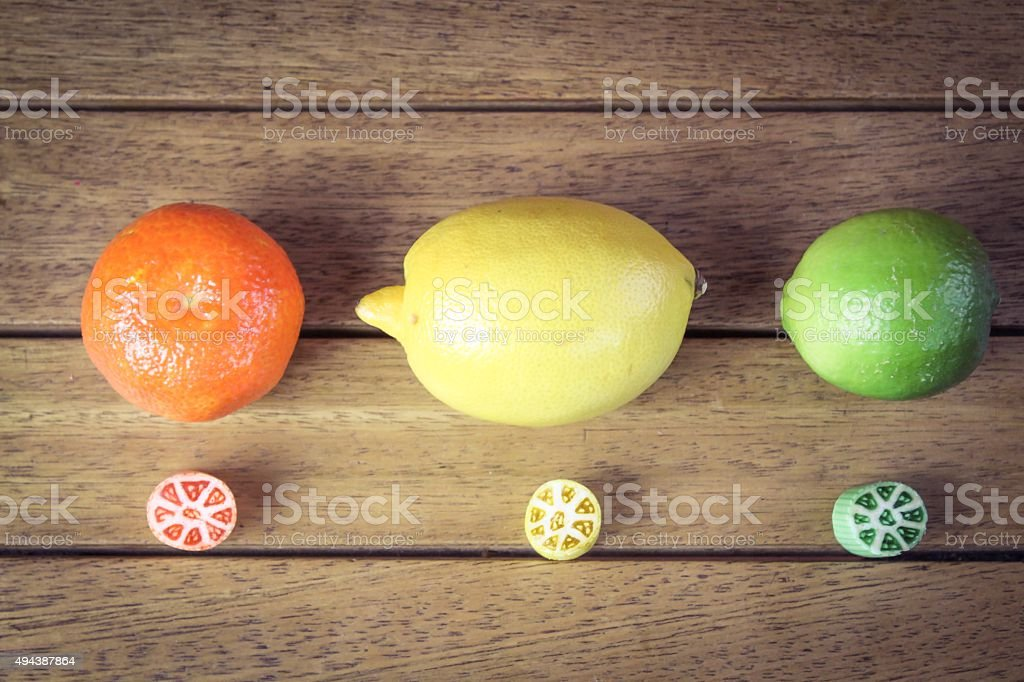 Traditional boiled sweets and thier corresponding fruits stock photo