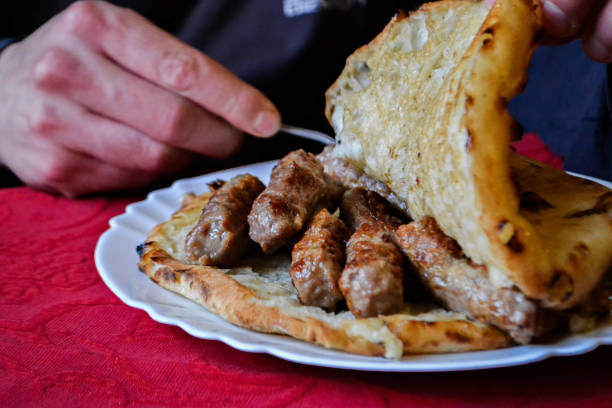 traditional bosnian and balkans food, meat in bread, cevapi - serbia stock photos and pictures