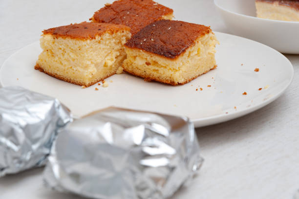 Traditional Brazilian dessert (known as Bolo Gelado) - Making step by step: Cake pieces wrapped and not wrapped in aluminum foil. Selective focus Traditional Brazilian dessert (known as Bolo Gelado) - Making step by step: Cake pieces wrapped and not wrapped in aluminum foil. Selective focus. gelado stock pictures, royalty-free photos & images