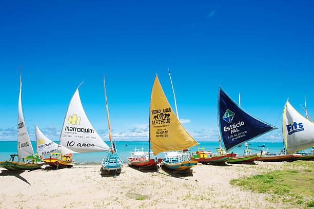 Traditional Brazilian Jangada Sailboats on Beach stock photo