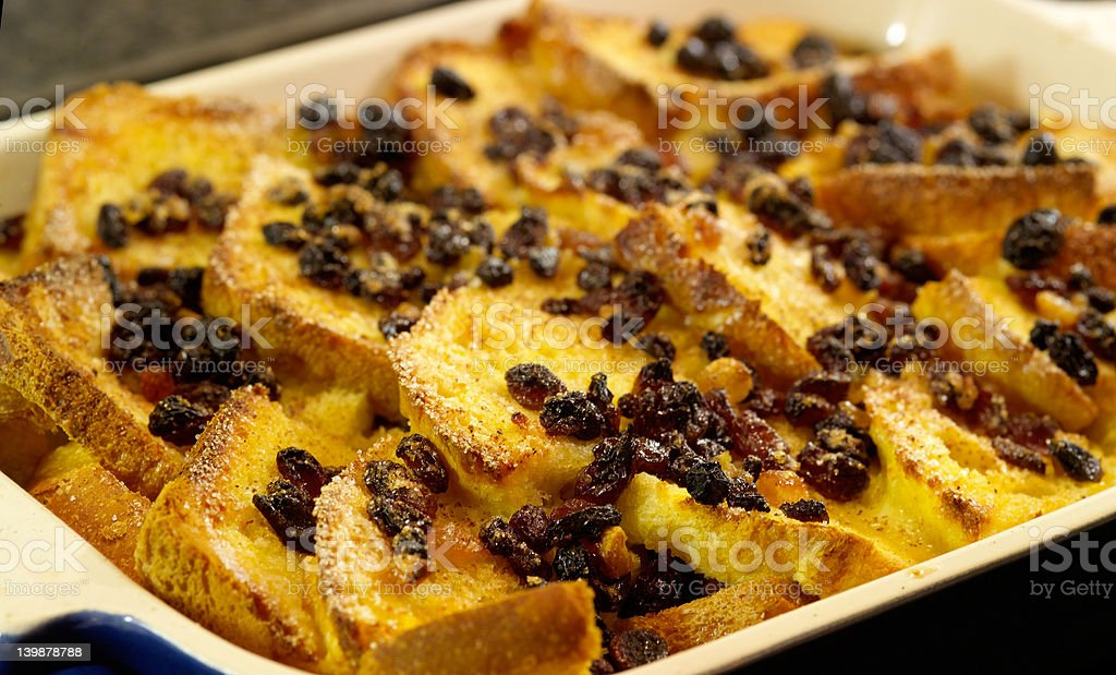 Traditional Bread and Butter pudding with egg custard, sugar stock photo