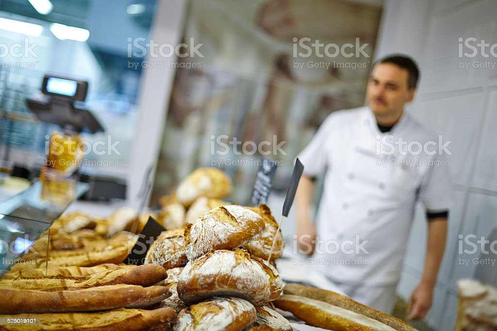 Traditional bread close up with baker at the backgorund stock photo