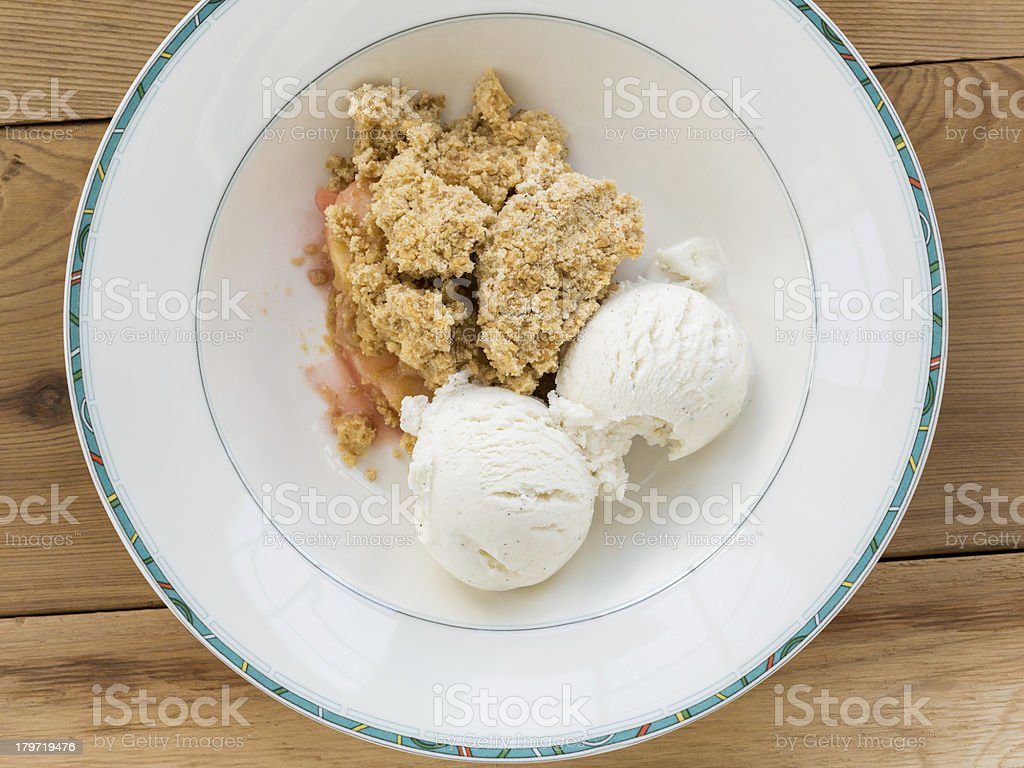 Traditional british apple crumble pie in dish with ice cream royalty-free stock photo