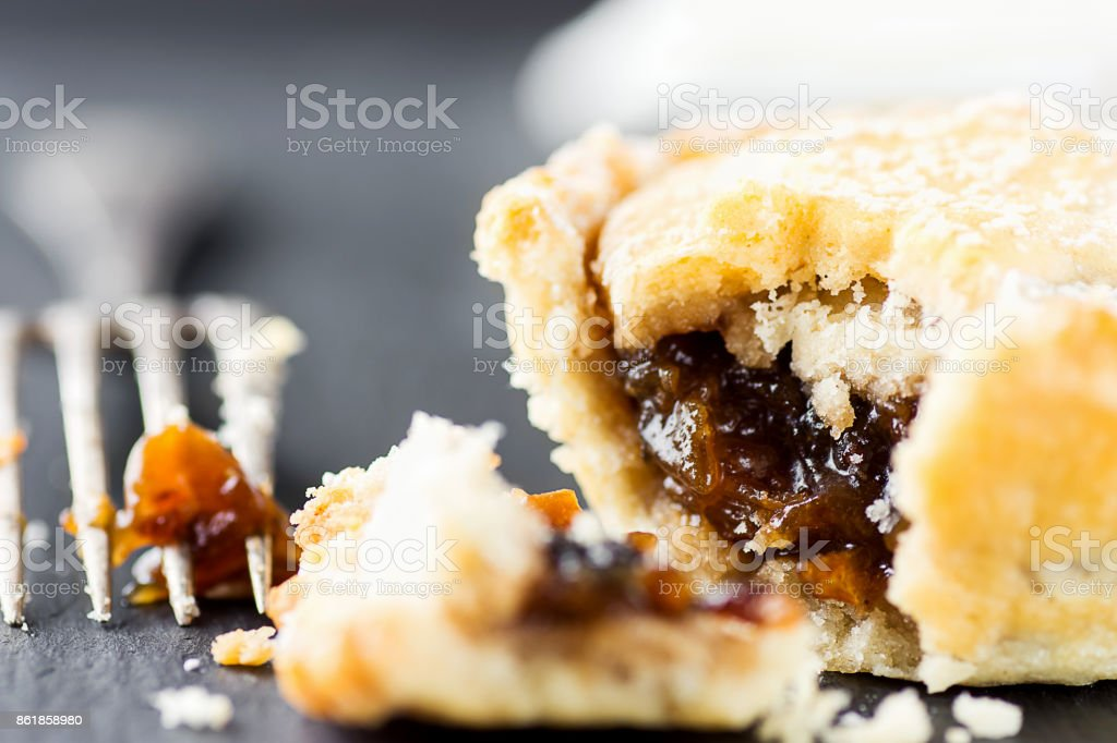 Traditional British Christmas Pastry Dessert Home Baked Mince Pie with Apple Raisins Nuts Filling. Open with Visible Texture. Golden Shortcrust Fork. Festive Table Setting stock photo