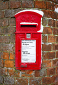 Buckingham, UK - February 01, 2019. A traditional British post box is set into a wall in Buckinghamshire. The post box dates from the reign of George VI from 1936 to 1952.