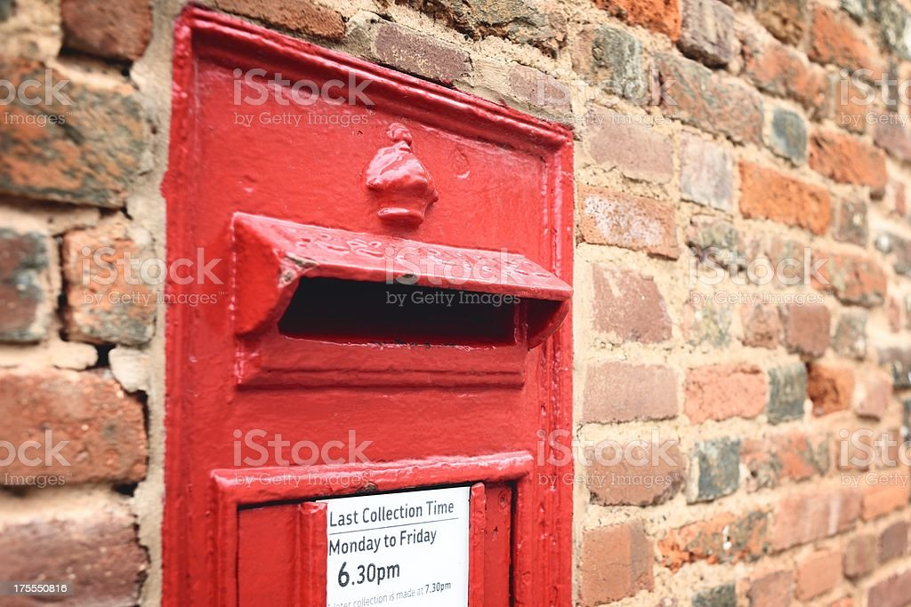 Traditional British Red Postbox in Wall royalty-free stock photo