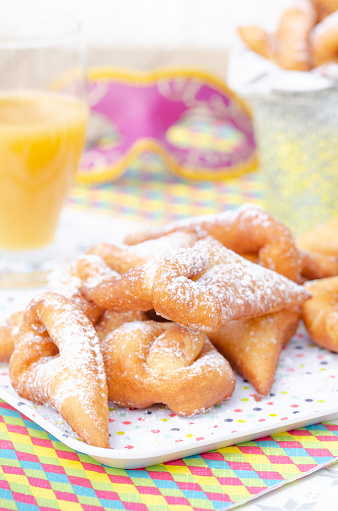 Traditional Bugnes Lyonnaises donuts served for Mardi Gras